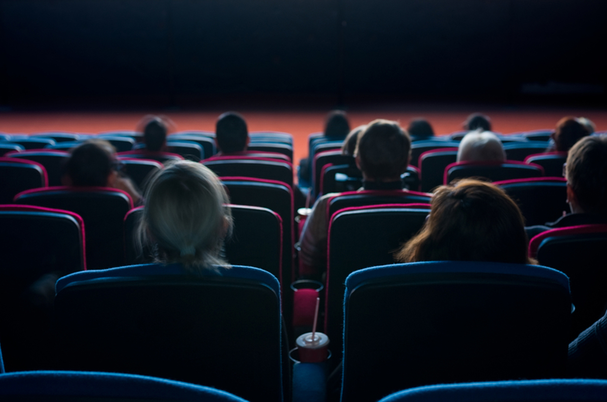 Slider Image People viewing film in cinema