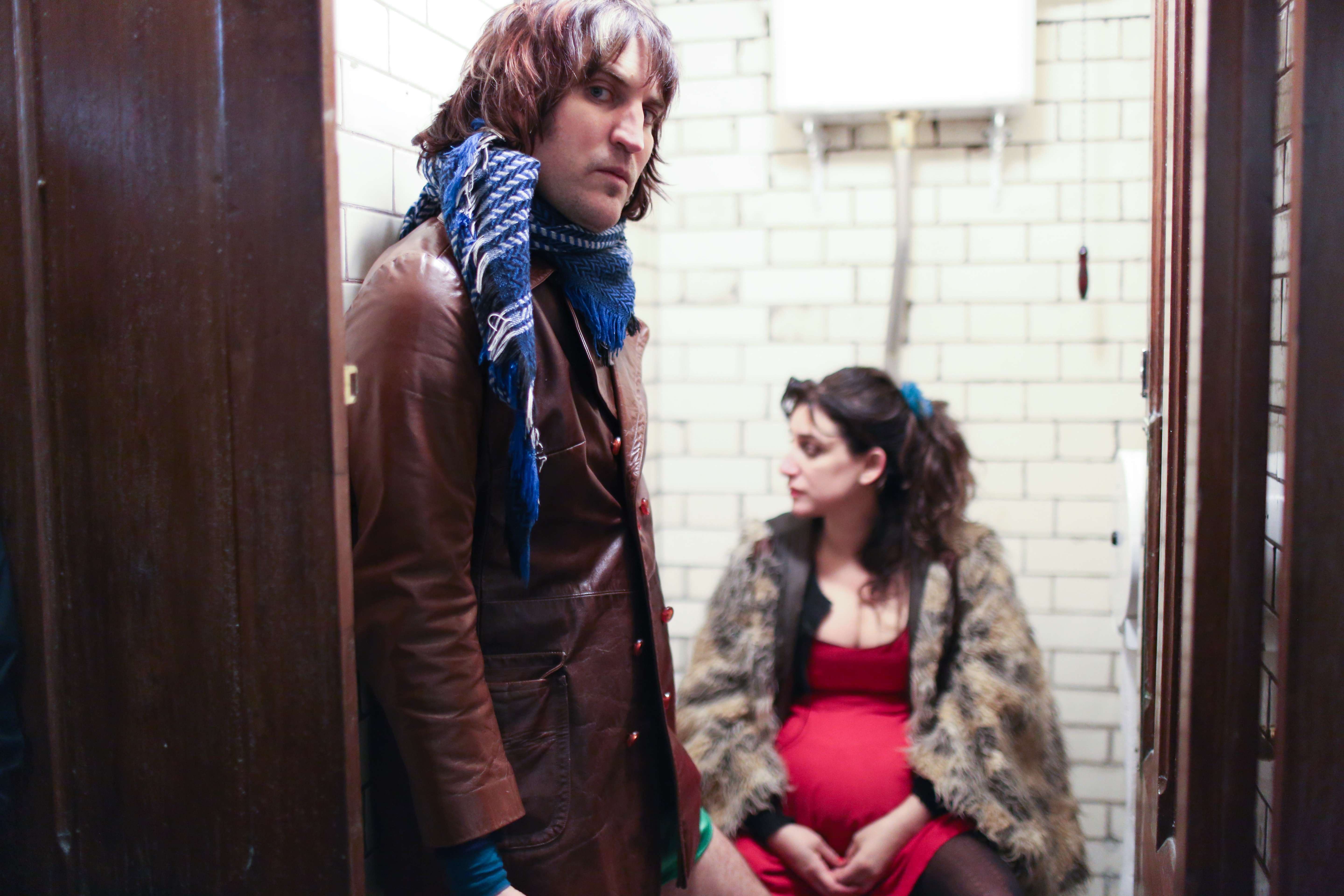 Noel Fielding in toilet cubicle with pregnant woman